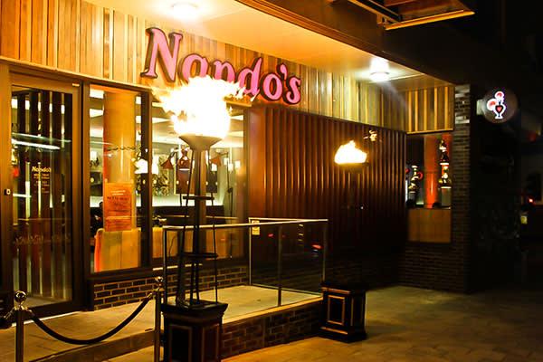 Nandos Restaurant Outdoor Lighting Red Carpet Flambeauxs