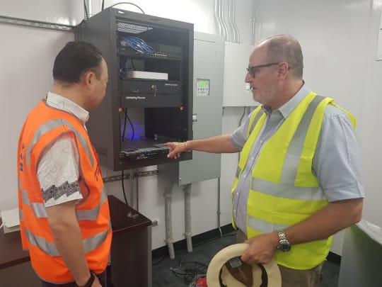Solomon Islands Submarine Cable Company CEO, Keir Preedy, describing the Cable Landing Station equipment to DFAT Project Head, Pablo Kang (Credit: DFAT)