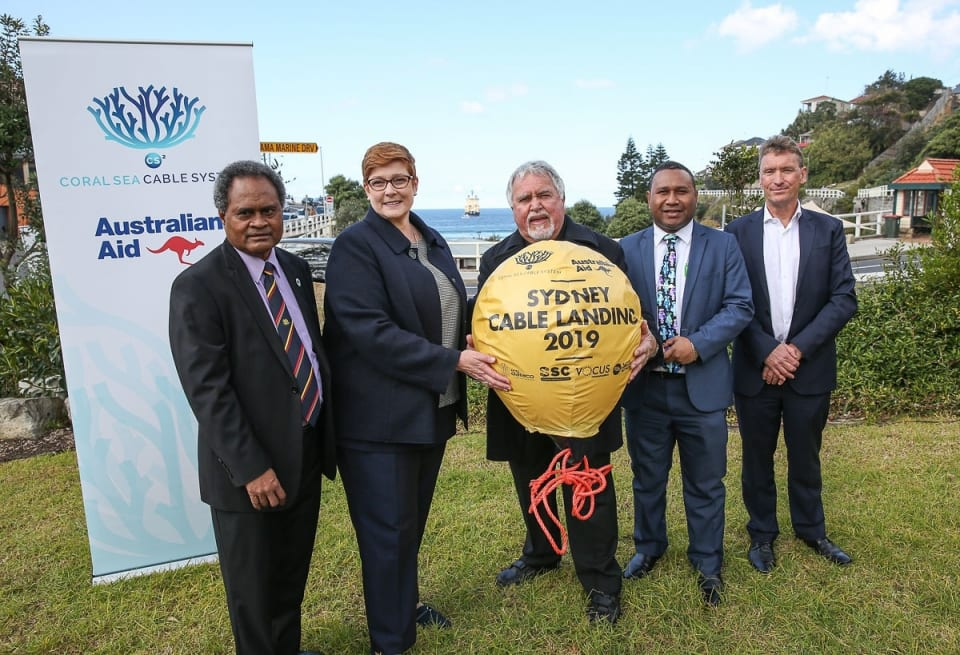 "Coral Sea Cable System landing ""golden buoy"" ceremony Left: Mr Leo Oaeke, Acting Consul General PNG, Senator Hon Marise Payne Minsiter for Foreign Affairs and Minister for Women, Dr Peter McKenzie, La Perouse Aboriginal Land Council Elder, Mr Walter Diamana, Acting High Commissioner for Solomon Islands, Mr Kevin Russell, Managing Director and CEO Vocus Group Ltd (Credit: DFAT/ Peter Morris – Sydney Heads)"