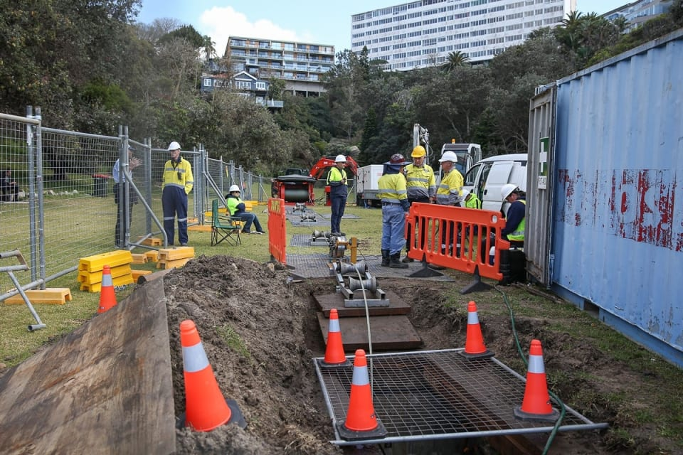 ASN crew hauling the cable under Tamarama Beach to the manhole under Tamarama Park (Credit: DFAT/ Peter Morris – Sydney Heads)