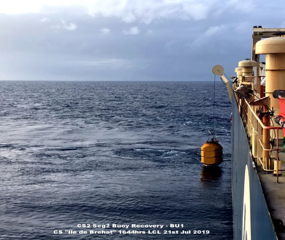 The cable laying vessel, the Ile de Brehat, stationed in the Coral Sea. The buoy marks the location of the PNG segment of the cable (Credit: Vocus)
