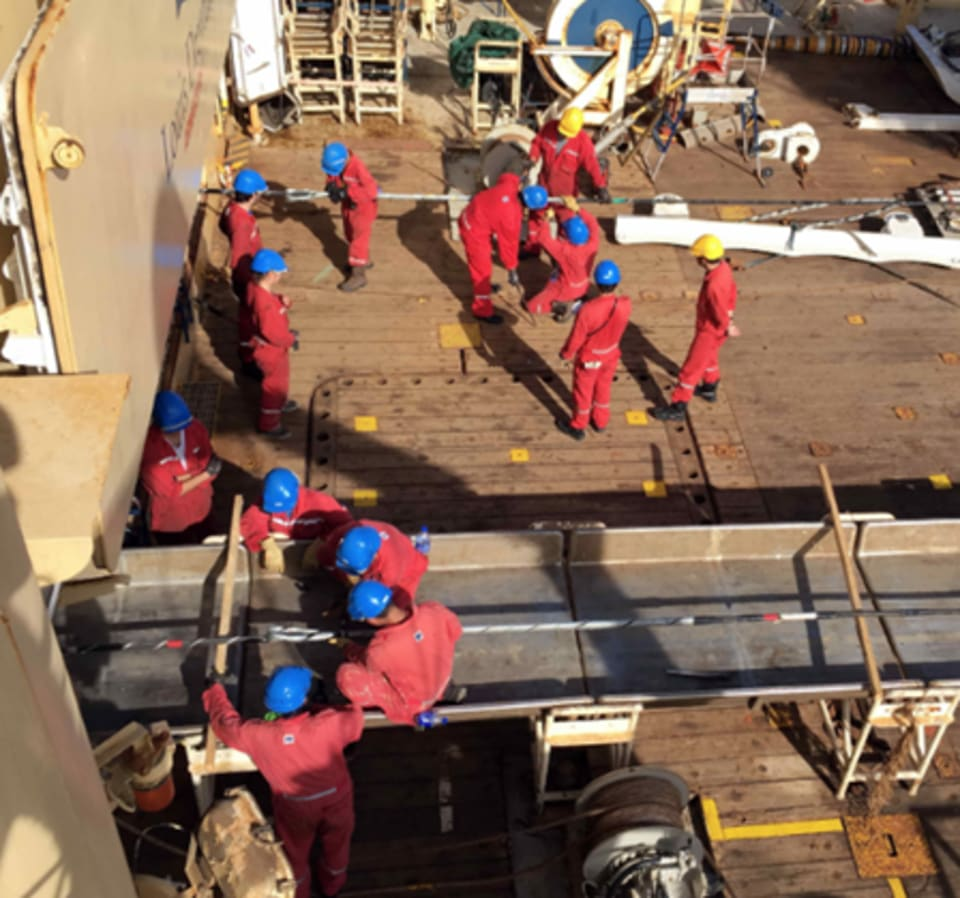 Cable retrieval works underway on the Coral Sea Cable laying vessel, the Ile de Brehat. (Credit: ASN)