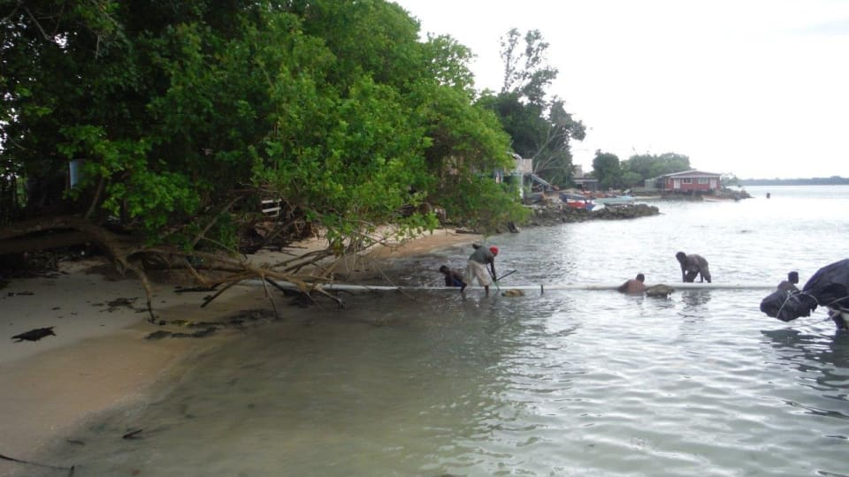 Fitting of the seaward ducts in Taro, Solomon Islands. (Credit: SISCC)