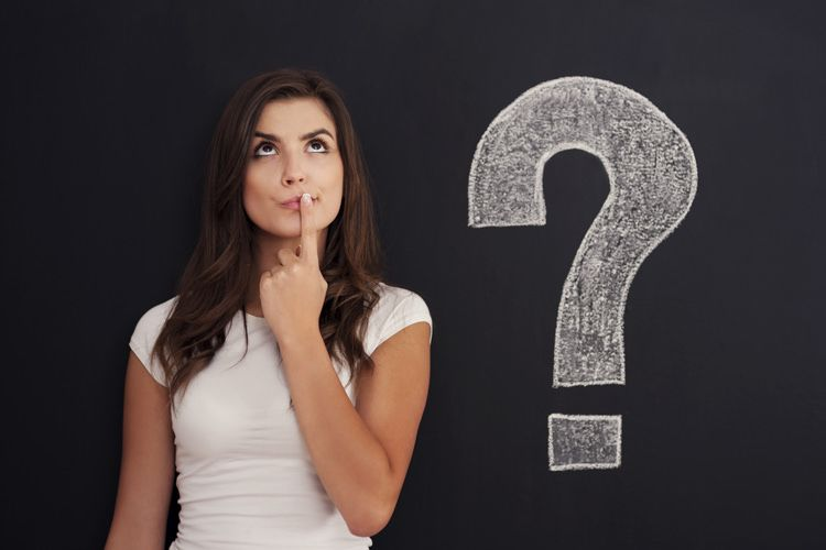 Woman next to a question mark