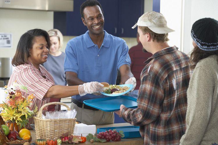 Folks serving food at a food shelter