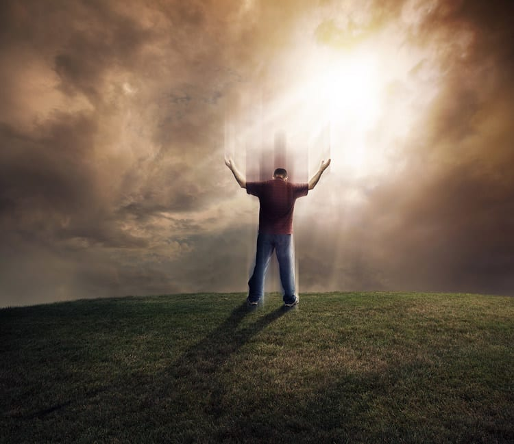 Man lifting up his soul and arms on grassy field