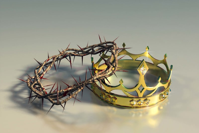 A picture of the crown of thorns besides a heavenly crown full of jewels.