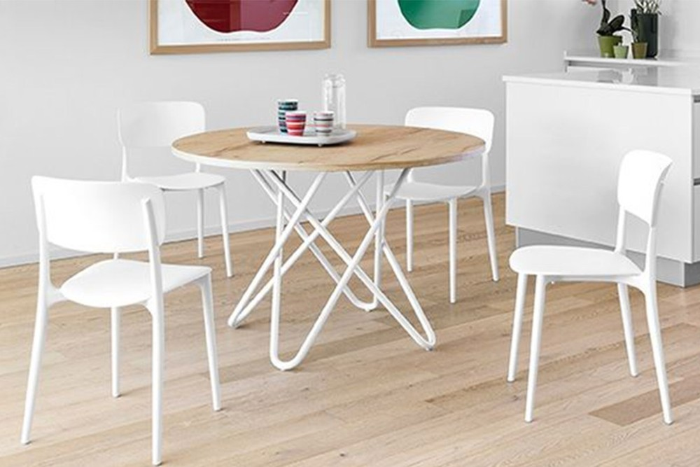 Stellar%201.jpg Stellar dining table _ By Calligaris _ Designed by Busetti Garuti Radaelli_ Made in Italy _ Fixed Round Table_ Intertwining elements in base_ Cosmic inspired_ Metal base Stellar%201.jpg