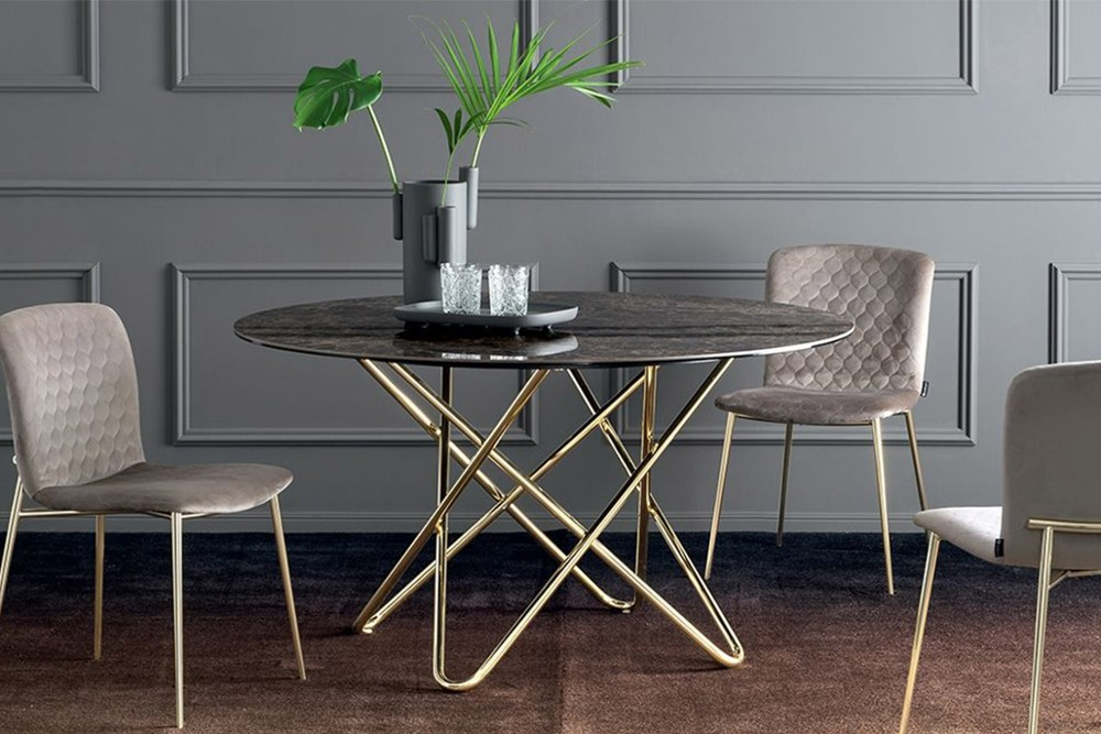 Stellar%205.jpg Stellar dining table _ By Calligaris _ Designed by Busetti Garuti Radaelli_ Made in Italy _ Fixed Round Table_ Intertwining elements in base_ Cosmic inspired_ Metal base Stellar%205.jpg
