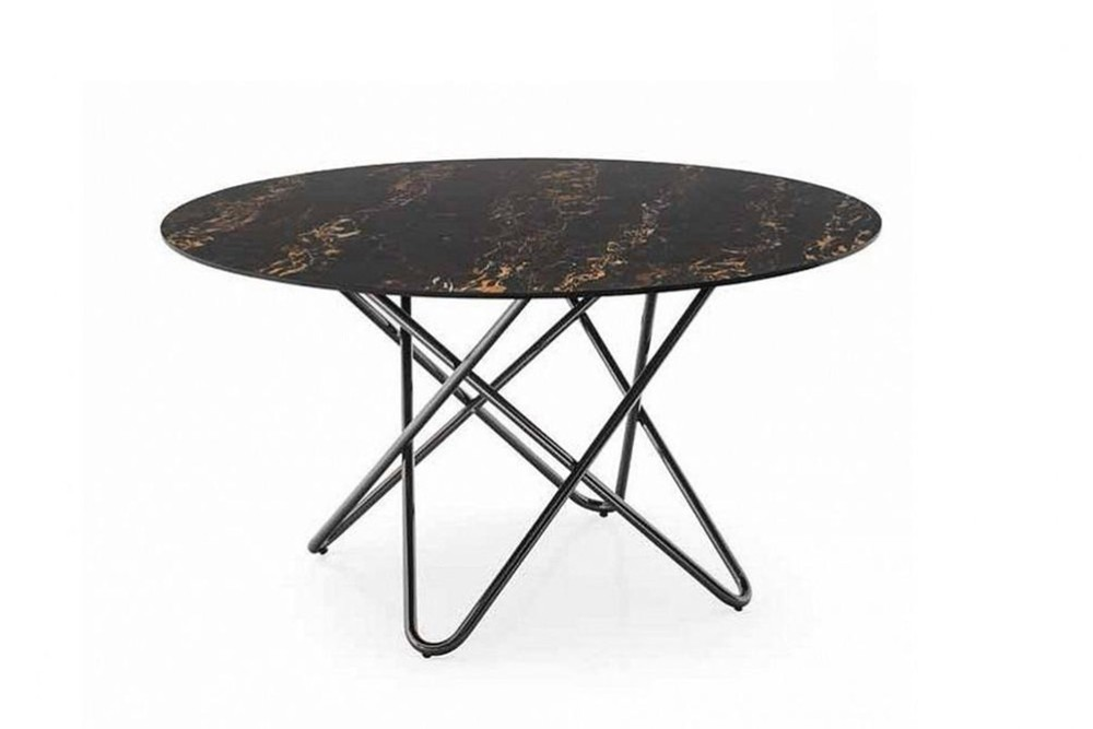 Stellar%203.jpg Stellar dining table _ By Calligaris _ Designed by Busetti Garuti Radaelli_ Made in Italy _ Fixed Round Table_ Intertwining elements in base_ Cosmic inspired_ Metal base Stellar%203.jpg