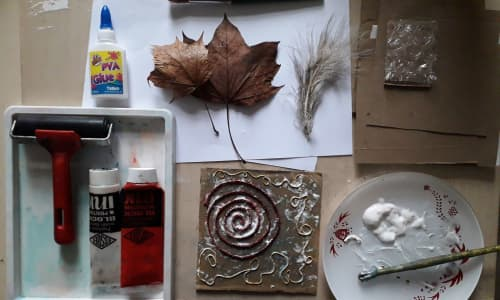 Printing materials, leaves and glue on a table