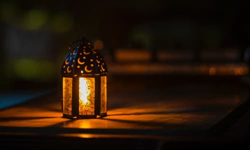 Ramadan light on top of a table at night