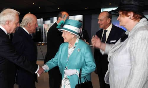 The Queen shaking hands with people