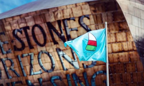 The Urdd flag flying outside of Wales Millennium Centre
