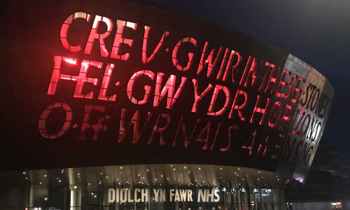 Wales Millennium Centre lit up red at night