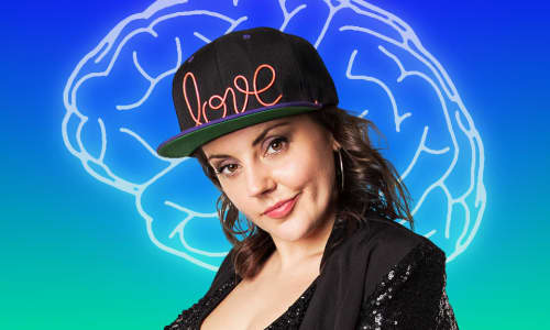 Carys Eleri stood in front of a green and blue background with an image of the brain
