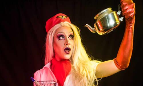 Drag act holding a tea pot