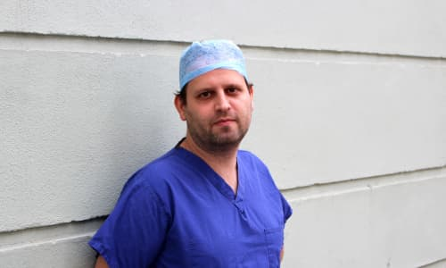 Author and Doctor, Adam Kay, in scrubs ahead of his performance at Wales Millennium Centre in March 2020