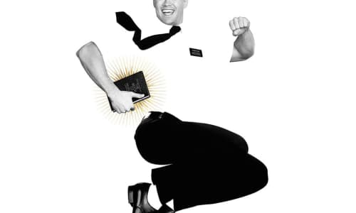 Black and white image of a smiling man leaping high into the air while clutching a bible under one arm