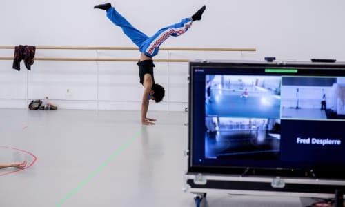 Rambert dancer with camera