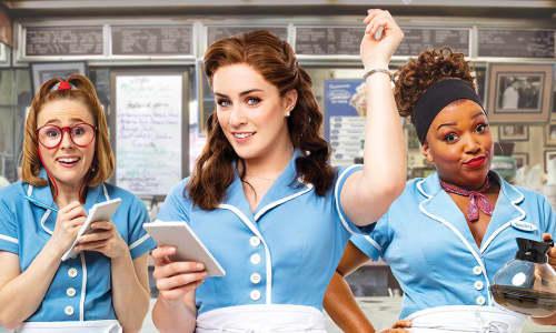 Three women dressed as waitresses
