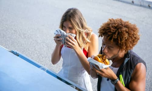 A couple eating street food