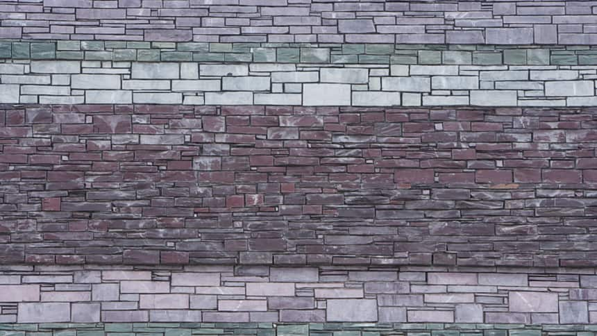 Slate cladding on the exterior represents local rock strata found along the local sea cliffs of South Wales