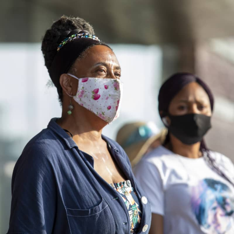 Two ladies wearing face masks