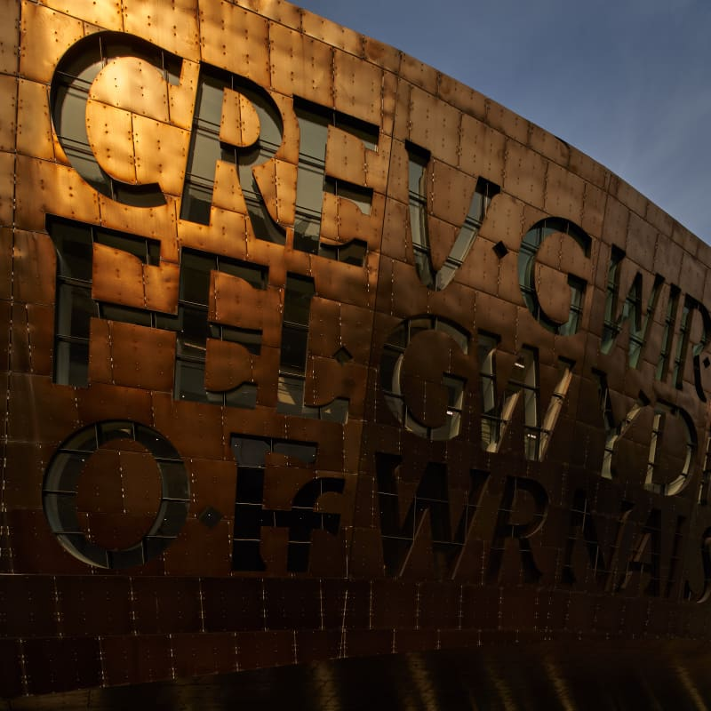 Copper coloured steel tiles on the exterior of wales Millennium Centre. Image © Simon Ridgway