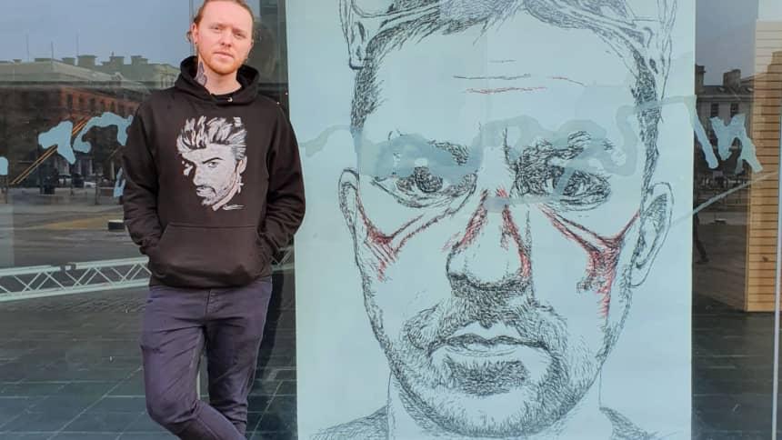 Nathan Wyburn stood next to some art