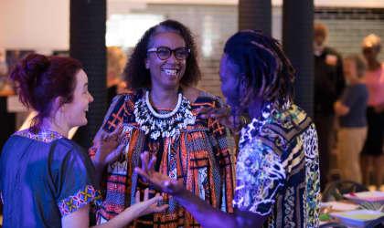 Three ladies talking at a community banquet event