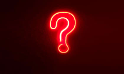 neon light in the shape of a question mark