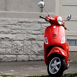 A two-seater Vespa rental