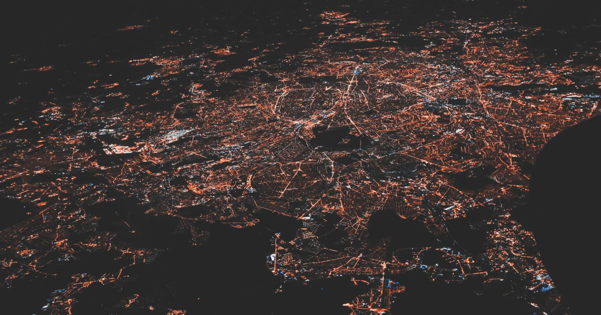 Birds-eye view of city street grid at night