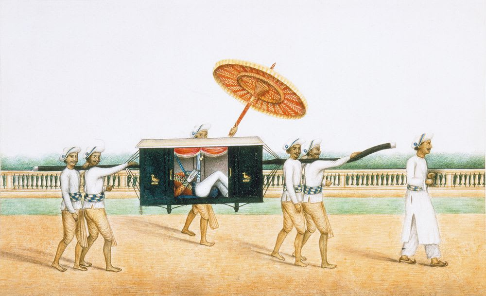 Watercolour painting of a group of Indian men carrying a western figure in a palanquin (a portable boxed seat). Four men carry the palanquin, another holds a parasol over it and a sixth leads the group which is walking left to right. Behind is a simple balustrade, greenery and a plain white sky.