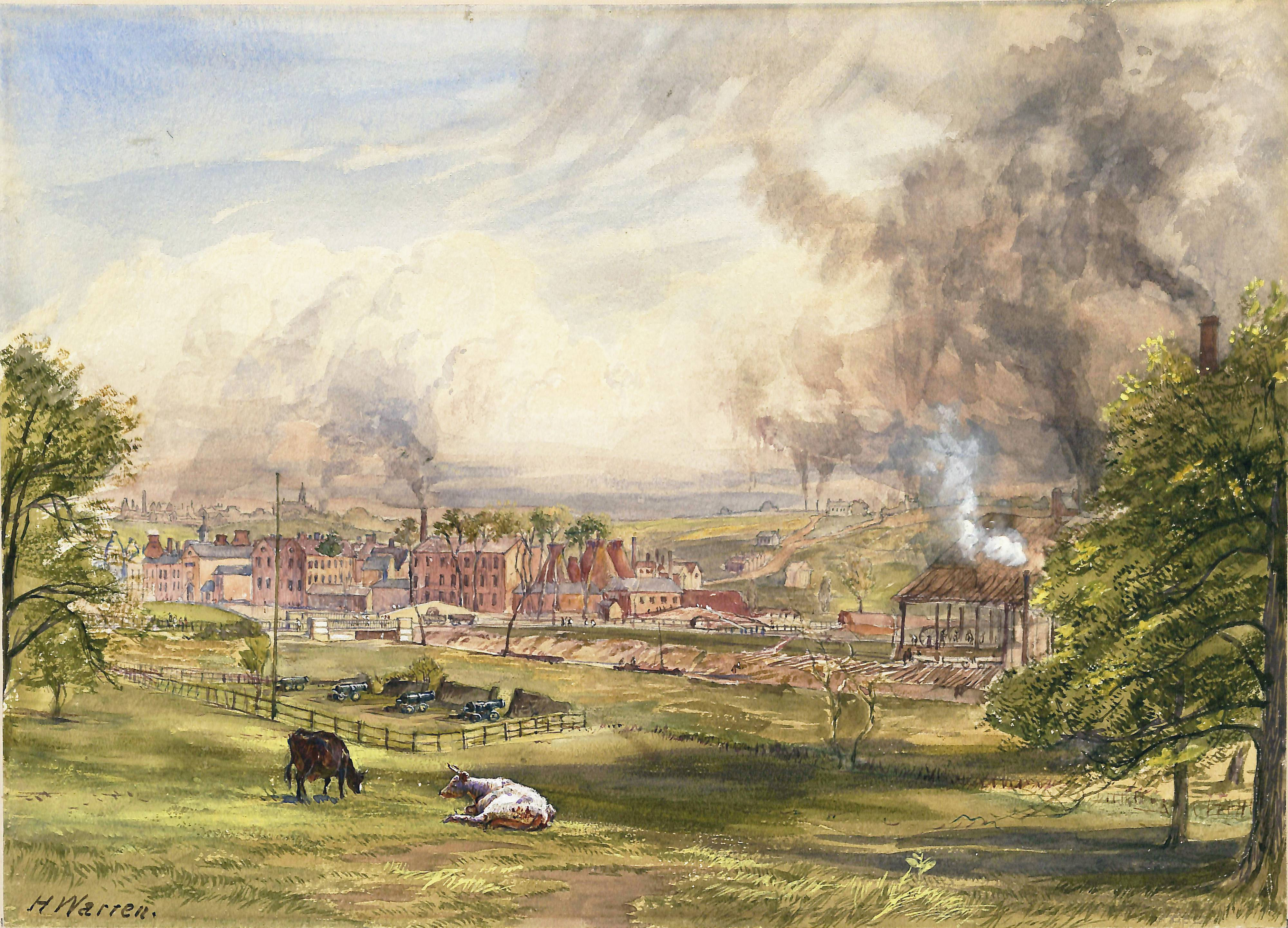 Watercolour painting. A field with two cows in the foreground and a small enclosure with cannon. In the distance, brick buildings with smoking industrial chimneys.