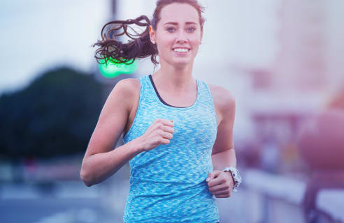 Woman with blue tank top running.
