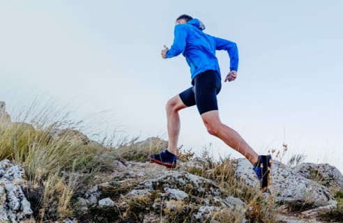 Runner running up a hill.