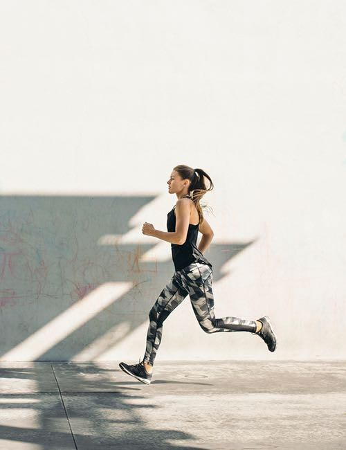 Image of a woman running.