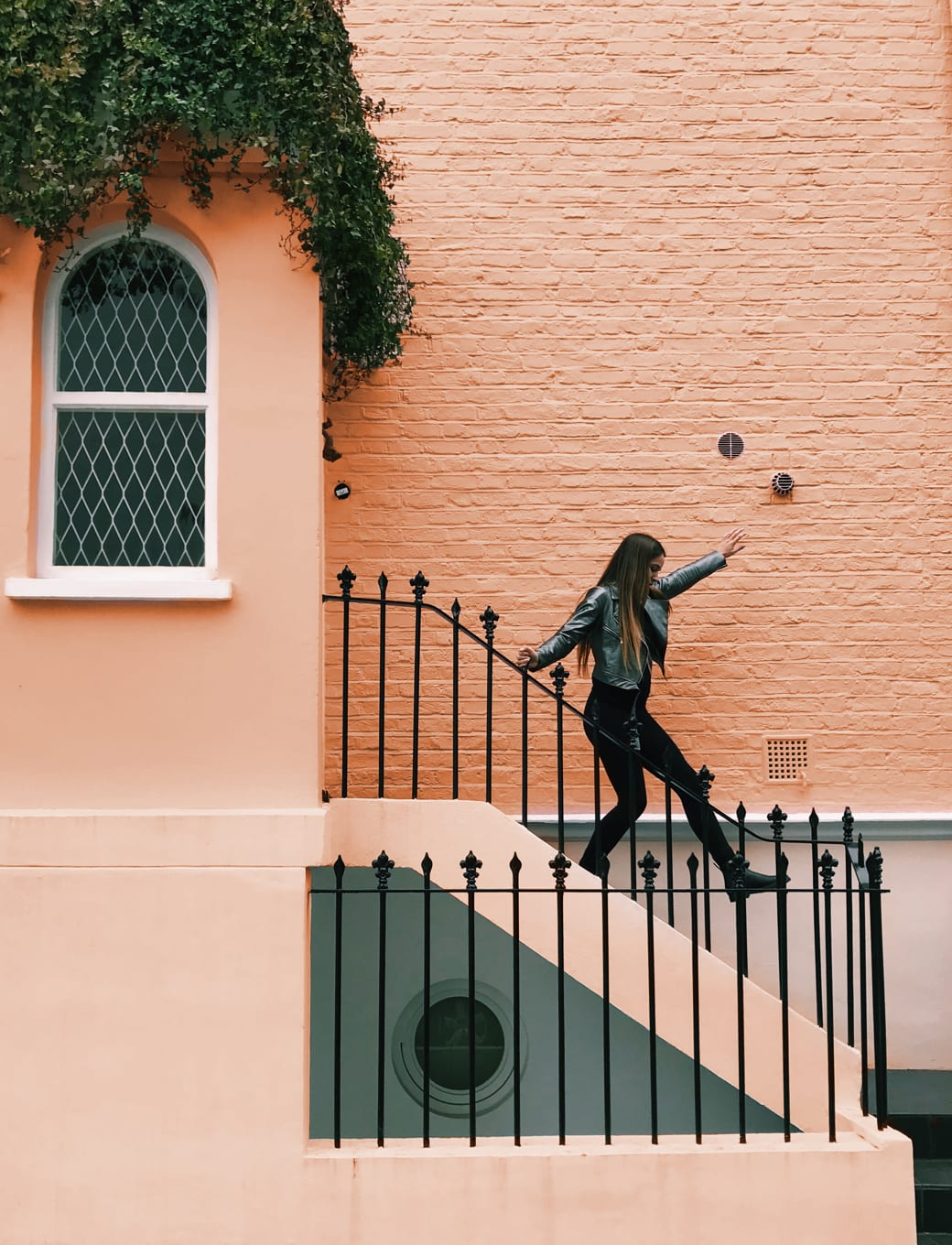 Image of a woman walking down steps.