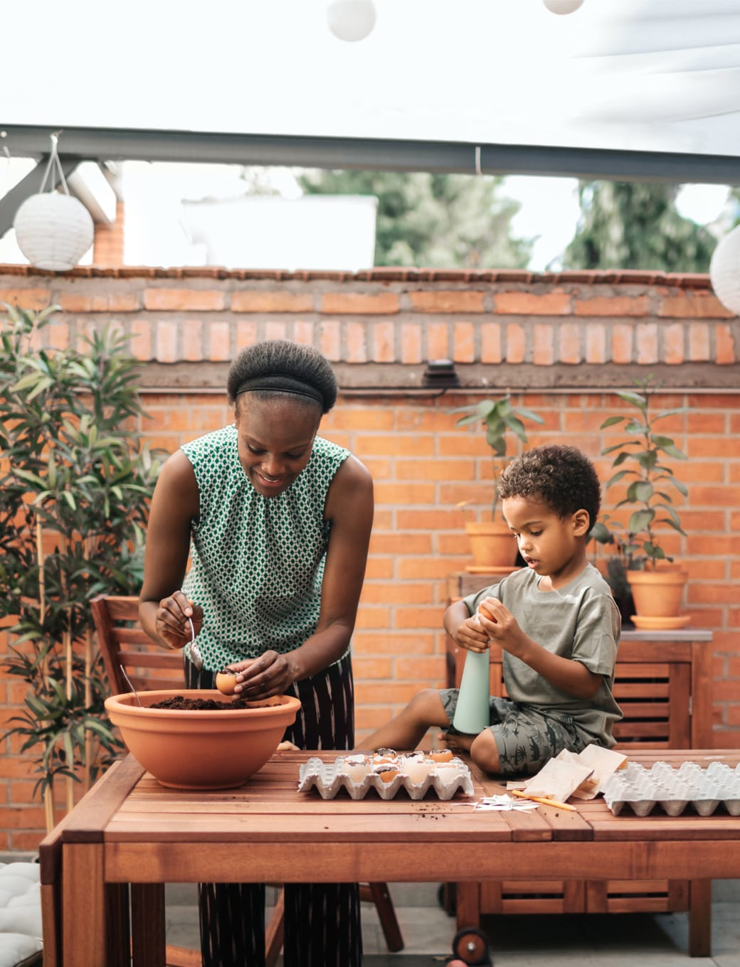 Image of a woman and child cooking.
