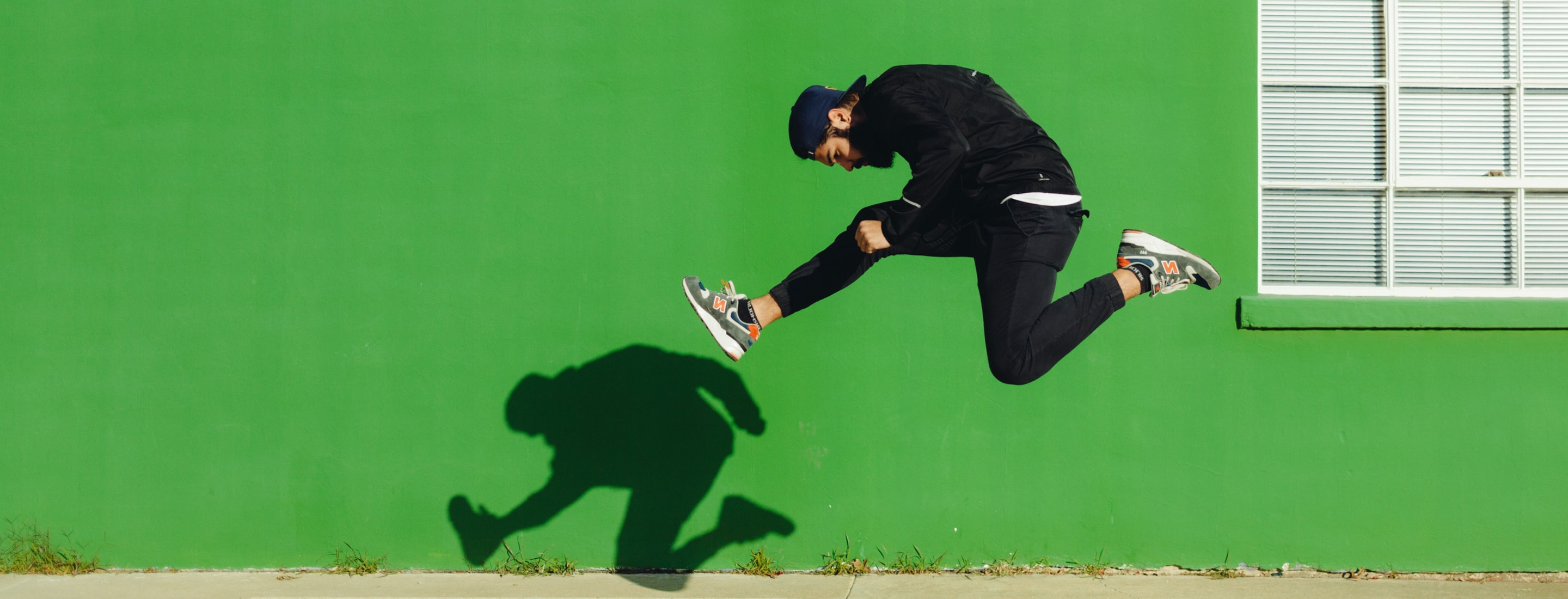 Image of male hurdling on the sidewalk