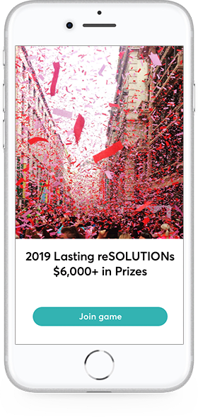 Red confetti falling from the sky on a crowd celebrating the new year.