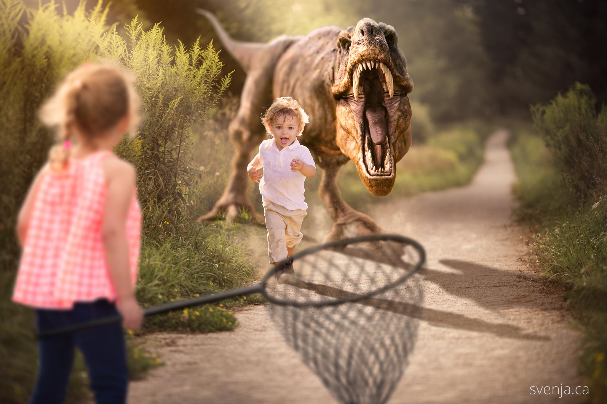 boy running from a dinosaur and girl with a net to save him