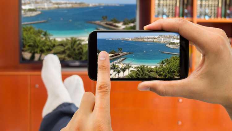 Bekijk je vakantiefoto's op groot scherm