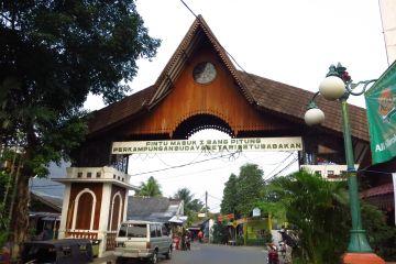 pintu masuk kampung budaya beawi