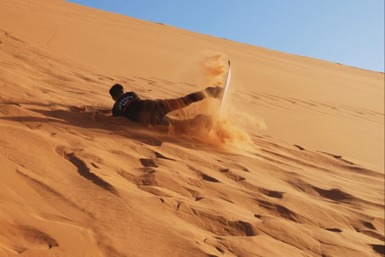 Sand boarding in Sahara