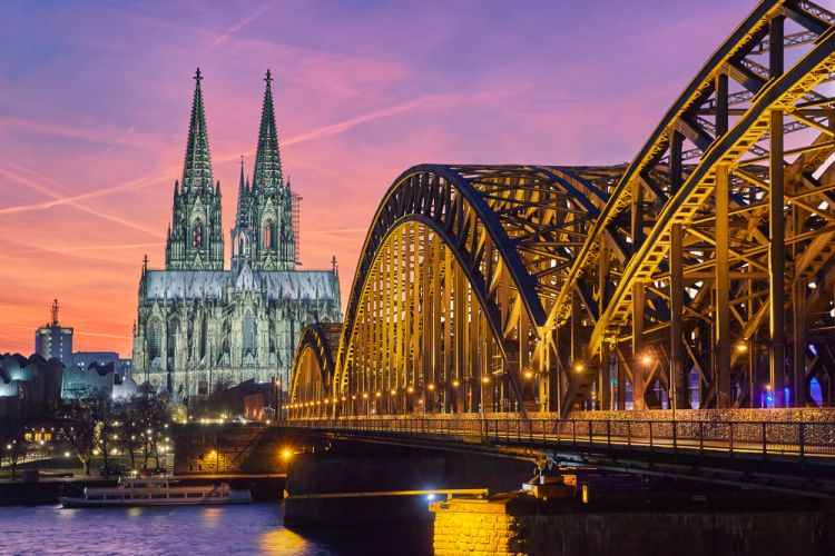 Best Scenic Routes for Your First Road Trip in Germany - Cologne Cathedral and Hohenzollern Bridge at sunset.