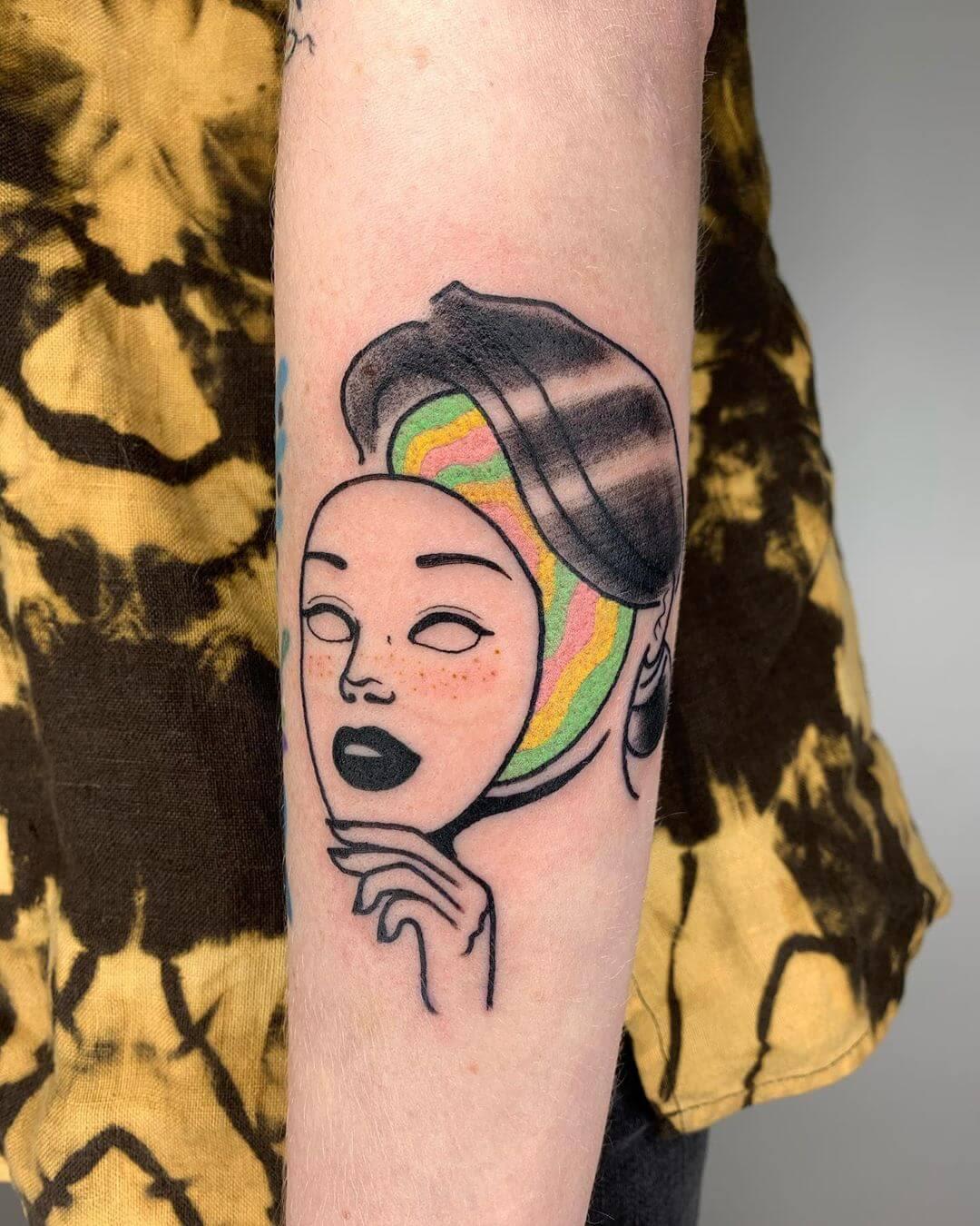 Blaabad rainbow face with mask female tattoo