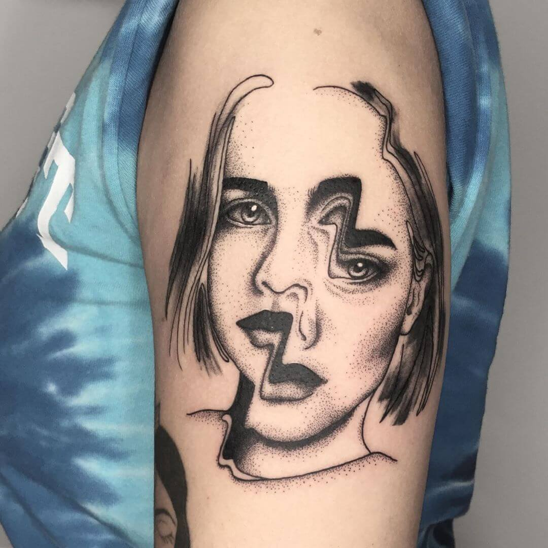 Distorted female portait tattoo by Filipa Vargas